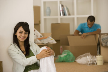 Young couple unpacking boxes in new house