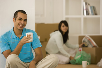 Young couple unpacking moving boxes