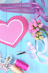 Scrapbooking craft materials on color wooden background
