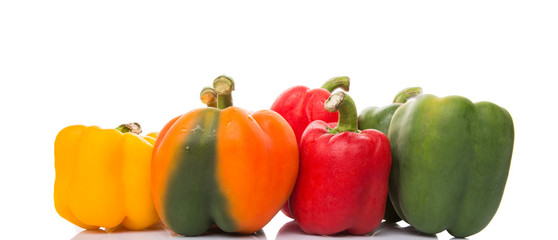 A group of different colors of capsicum over white background