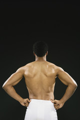 Rear view of African American man wearing towel