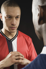 Multi-ethnic soccer players looking at each other