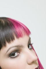 Hispanic woman with dyed hair