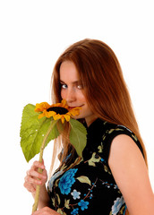Portrait of girl with sunflower.