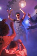 Asian woman dancing at nightclub