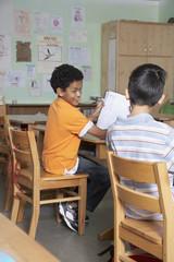 Multi-ethnic boys in classroom