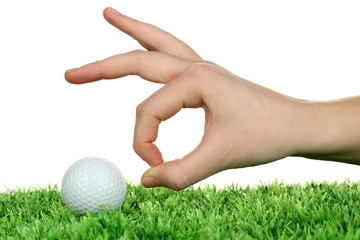 Golf ball and hand isolated on white