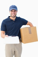 Happy delivery man with cardboard box and clipboard