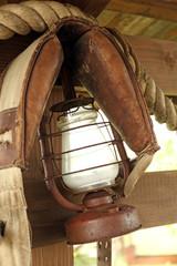 Kerosene lamp on wooden fence