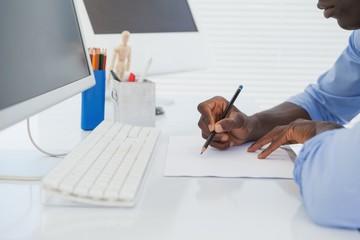 Businessman drawing at his desk