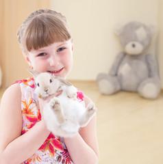 girl kissing a rabbit.