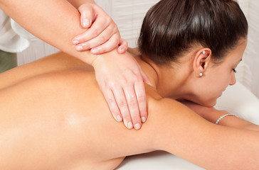 Young women getting back massage