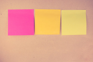 Colorful post it on vintage paper cardboard background