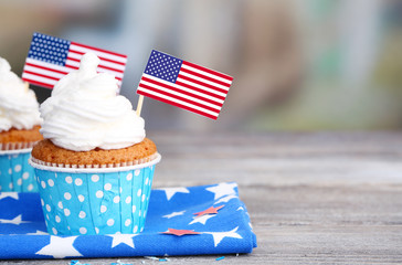 American patriotic holiday cupcakes on wooden table