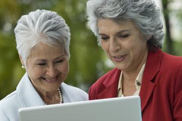 Senior Hispanic women looking at laptop