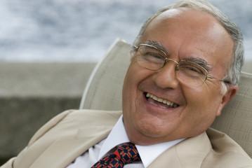 Senior Hispanic man laughing