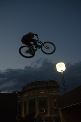 Jumping cyclist silhouette