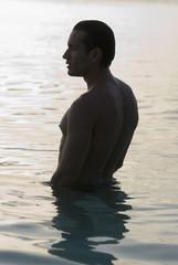 Hispanic man standing in water