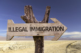 Illegal Immigration wooden sign with a desert background - Fine Art prints