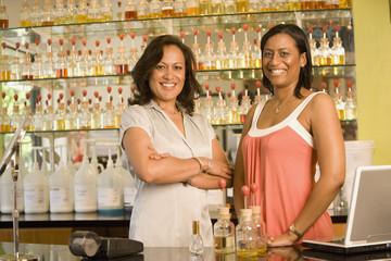 Multi-ethnic female sales clerks at perfume store