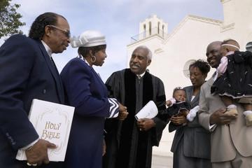 African Reverend greeting parishioners