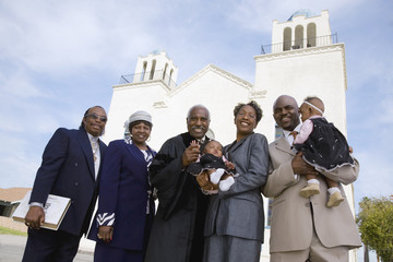 African family in front of church