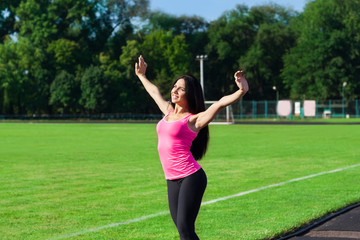 Woman sport excited raised arms up