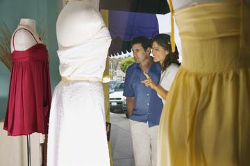 Hispanic couple window shopping