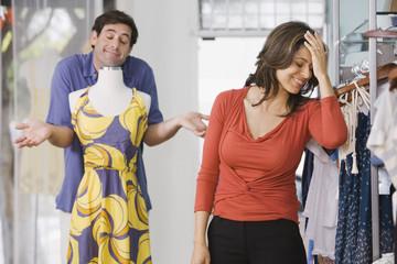 Hispanic couple shopping in clothing store