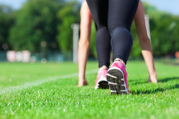 Woman sport run on stadium green grass concept