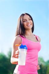 woman drink water bottle sport on stadium