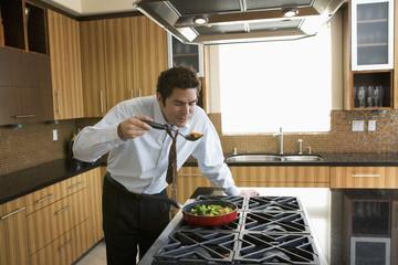 Hispanic businessman tasting foo