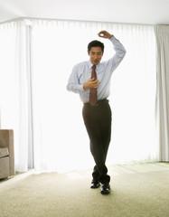 Asian businessman dancing
