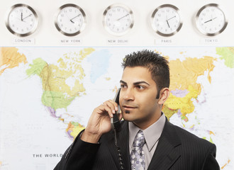 Indian businessman talking on te