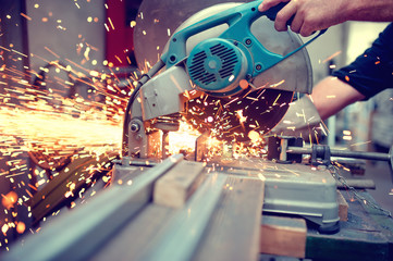 industrial engineer working on cutting a metal and steel