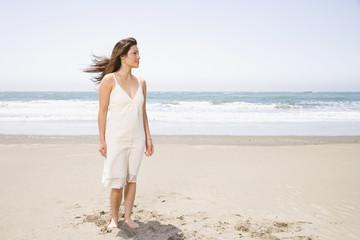 Asian woman standing on beach