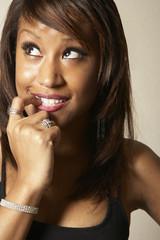 African American woman biting fi