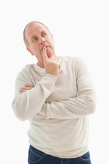Thinking mature man with hand on chin