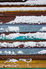 Colorful board covered with snow.