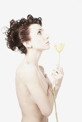 Nude woman holding flower