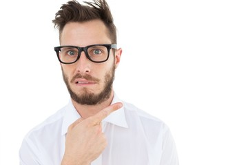 Geeky young businessman looking at camera and pointing
