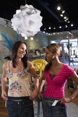 Multi-ethnic women clothing shopping