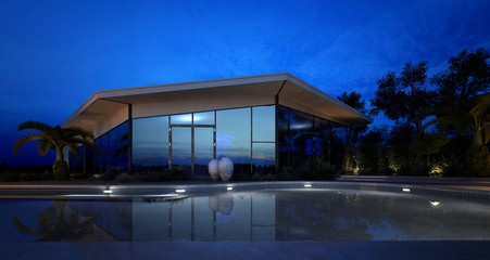 Illuminated pool in front of an upmarket villa