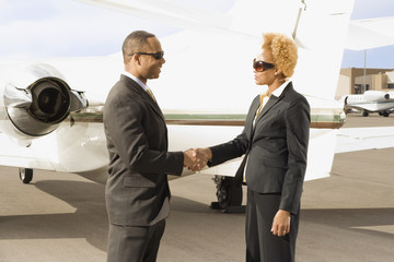 African American businesspeople shaking hands