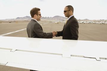 Multi-ethnic businessmen shaking hands