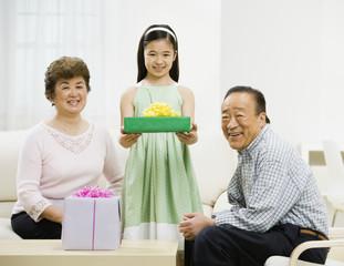 Asian girl holding gift