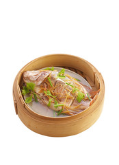 chinese food in bamboo basket on white background