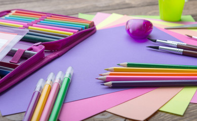 Many school stationery in a heap, cozy colors