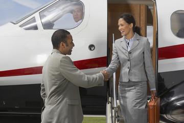 Multi-ethnic businesspeople shaking hands