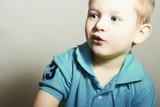 Funny Child. Little Boy with Blue Eyes.Children emotion